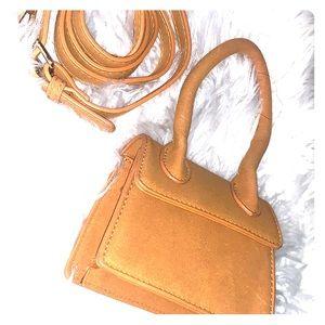 Handbags - NWOT Mini mustard faux suede bag